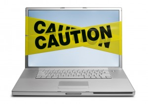 laptop-w-caution-tape